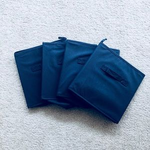 Four Navy Blue Storage Bins